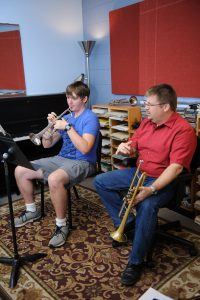 trumpet professor working with student