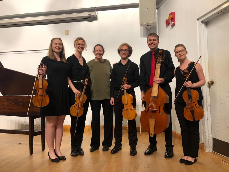 early chamber ensemble posing on stage