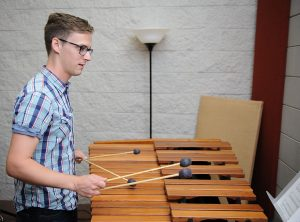student practicing on a xylophone