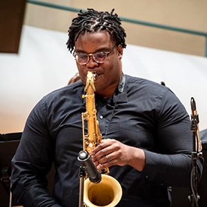 UA student performing with saxophone